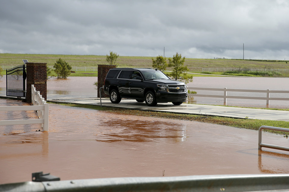 Photo - A vehicle leaves a driveway on NW 178 just west of Portland in Oklahoma City, Tuesday, May 21, 2019. [Bryan Terry/The Oklahoman]
