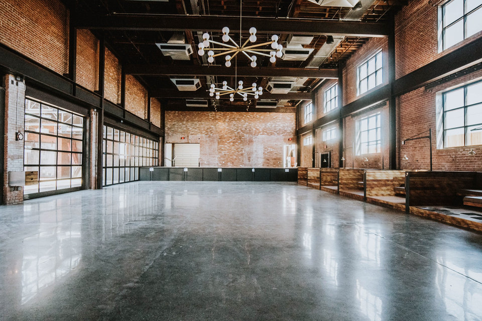 Photo -  The Jones Assembly features a 225-seat restaurant with separate downstairs and mezzanine bars and a 1,600-person capacity for live events. The venue renovated two historic facilities that were formerly part of The Fred Jones Manufacturing Co. complex. [Photo provided by Madison Denton]