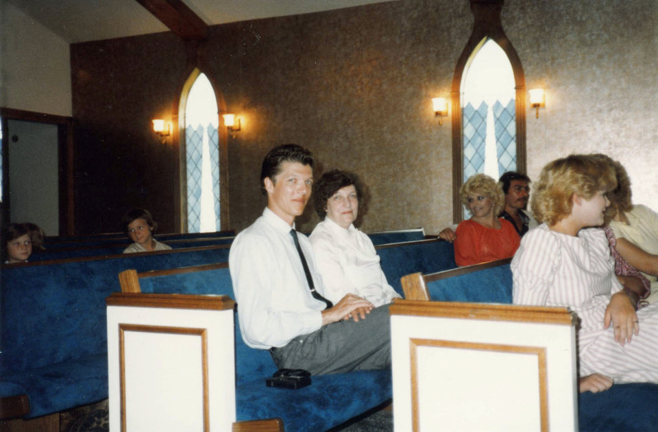 John Patrick Williams sits in church with his mother, Marie Williams. The two were found slain in their Norman home Dec. 6, 2003.  PHOTO PROVIDED BY NORMAN POLICE DEPARTMENT