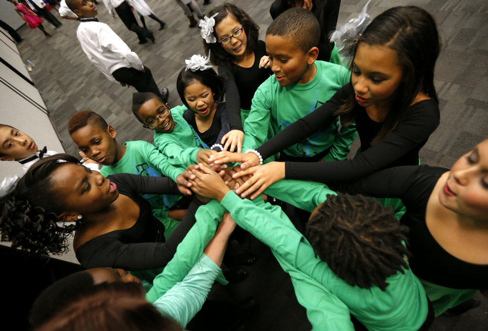 Photo - Dancers from Wiley Post Elementary gather backstage before performing during a ballroom dance competition at the Rose State Performing Arts Theatre. Photos by Bryan Terry, The Oklahoman