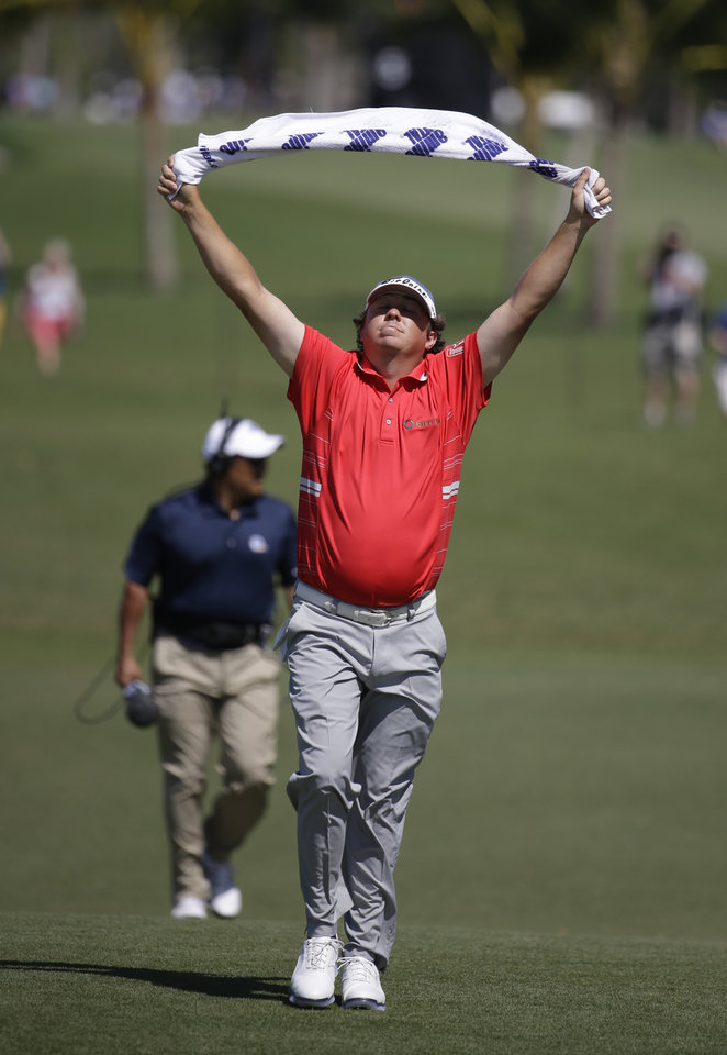 Photo - Jason Dufner walks up to the fourth hole during the second round of the Cadillac Championship golf tournament Friday, March 7, 2014, in Doral, Fla. (AP Photo/Lynne Sladky)