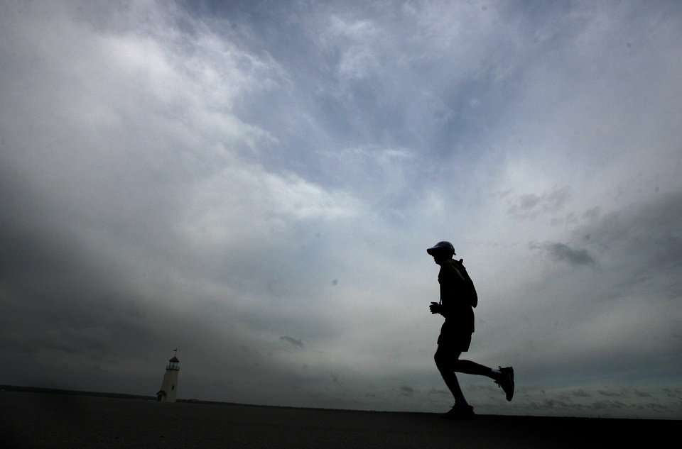 A marathon runner runs on the Lake Hefner trails during the 8th annual Oklahoma City Memorial Marathon on Sunday, April 27, 2008, in Oklahoma City, Okla.