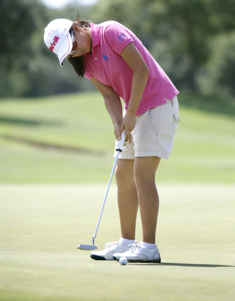 Photo - Mika Liu makes a putt during the match play semifinals of the WSGA championship at Gaillardia Country Club in Oklahoma City, OK, Thursday, June 5, 2014,  Photo by Paul Hellstern, The Oklahoman