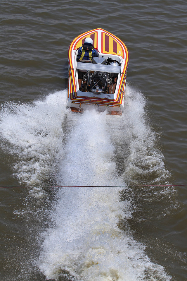 Steve Thomas in Juan Bad Party races down the course during the Oklahoma City Nationals Drag Boat races on the Oklahoma River Saturday, June 9th, 2012. PHOTO BY HUGH SCOTT, FOR THE OKLAHOMAN  ORG XMIT: KOD