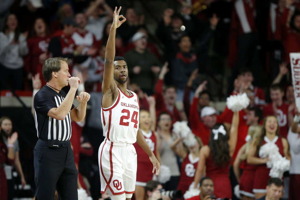 Photo - Oklahoma's Jamal Bieniemy (24) celebrates after making a 3-pointer during a men's NCAA basketball game between the University of Oklahoma Sooners (OU) and the Baylor Bears at the Lloyd Noble Center in Norman, Okla., Tuesday, Feb. 18, 2020. [Bryan Terry/The Oklahoman]