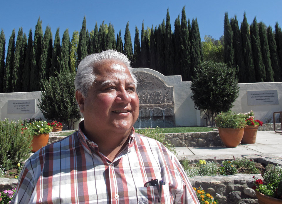 Photo -   In this photo taken Tuesday Oct. 2, 2012, Paul Chavez, Cesar Chavez's middle son and president of the Cesar Chavez Foundation stands near his father's grave site in the memorial garden in Keene, Calif. Today, the foothills of the Tehachapi mountains continue to house the United Farm Workers of America headquarters and memorials to Chavez, though farmworkers no longer live there. President Obama is designating parts of the property as a national monument and visiting the site on Monday, a move seen as likely to shore up support from Hispanic and progressive voters just five weeks before the election. (AP Photo/Gosia Wozniacka)