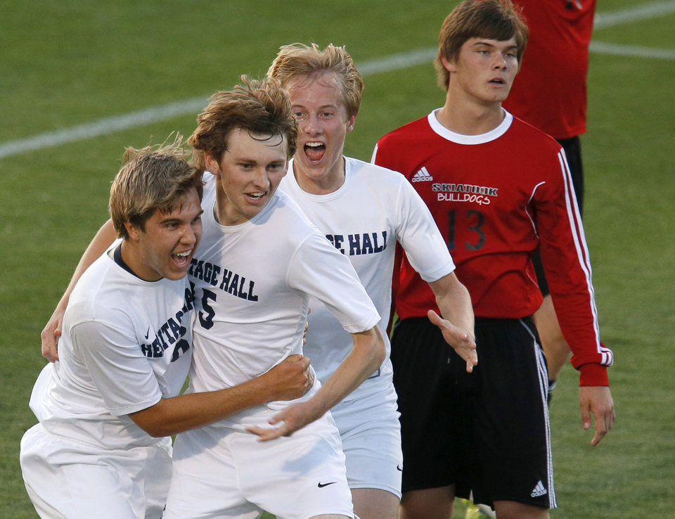 Photo - Heritage Hall's Matt McLaughlin, left, celebrates with Stefan Dolese and Garrett McLaughlin (3) after a goal by  Dolese as Skiatook's James Kriege watches during the Class 5A boys soccer championship between Heritage Hall and Skiatook in Norman, Okla., Friday, May 16, 2014. Photo by Bryan Terry, The Oklahoman