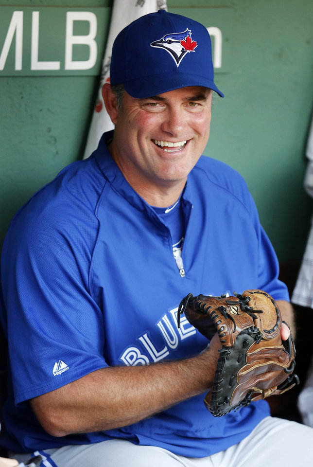 Photo -   FILE - In this Sept. 7, 2012, file photo, Toronto Blue Jays manager John Farrell sits in the dugout before the Blue Jays' baseball game against the Boston Red Sox in Boston. The Red Sox reportedly have reached an agreement to bring Farrell to Boston to replace Bobby Valentine. Red Sox spokeswoman Pam Kenn said early Sunday, Oct. 21, 2012, the team had no announcement to make. Comcast SportsNet New England reported that the deal was agreed to. (AP Photo/Michael Dwyer, File)