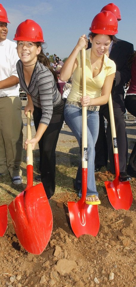 OKLAHOMA CITY, OK. WEDNESDAY 9-22-04. U.S. GRANT MAPS FOR KIDS GROUND BREAKING. GROUNDBREAKING: Sophomore class president Nicole Davis (cq NICOLE DAVIS), 15, at left, and junior class president Leslie Johnson (cq LESLIE JOHNSON), 17, at right, wielding shovels along with school officials and dignitaries to break ground on phase one construction of the new U.S. Grant High School in the Oklahoma City Public School District. When completed phase two will be the demolition of the old school and construction of new athletic fields and parking lots. Staff photo by Paul B. Southerland