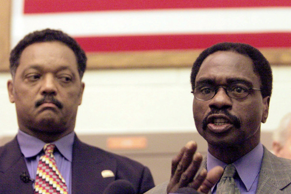 Photo - FILE - In this March 3, 2000 file photo, the Rev. Jesse Jackson, left, listens as Rubin