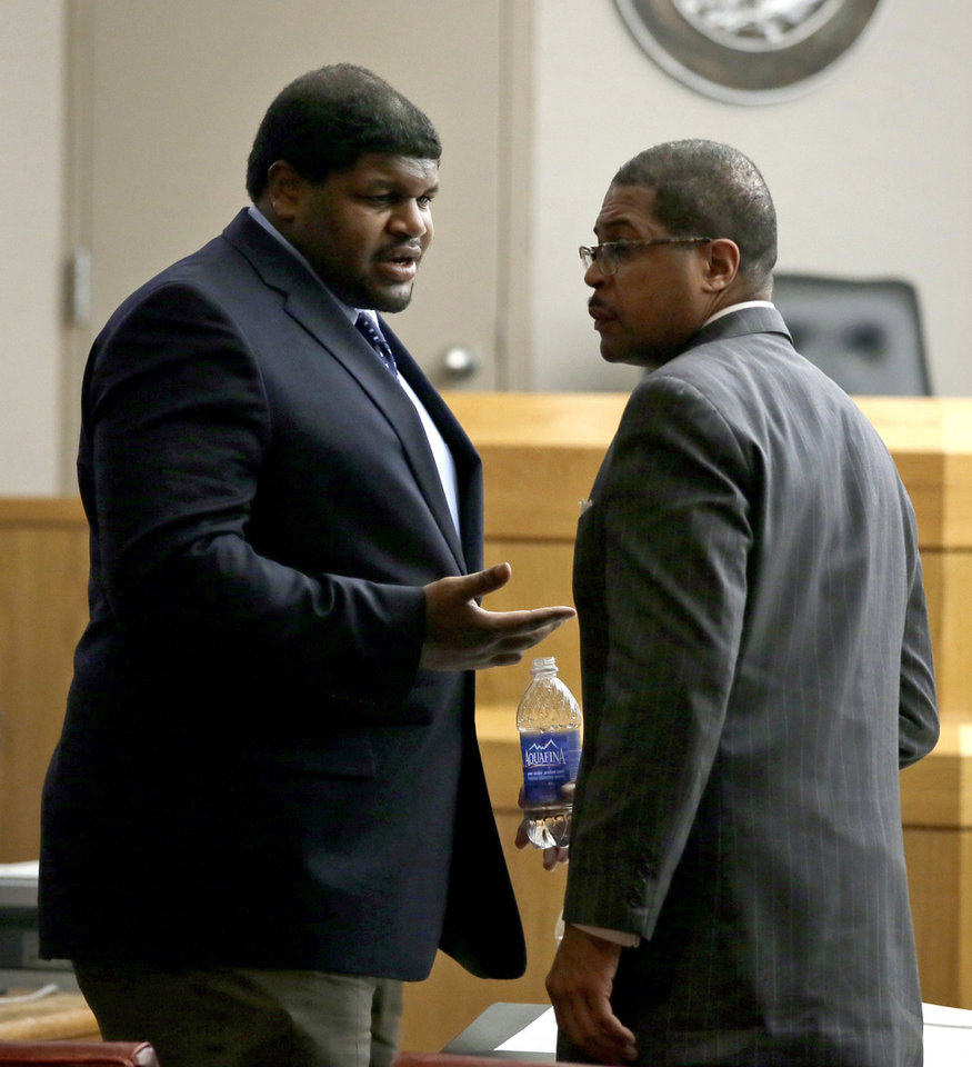 Photo - Former Dallas Cowboy player Josh Brent, left, talks in court with Kevin Brooks, a member of his defense team during Brent's trial for intoxication manslaughter, Friday, Jan. 17, 2014, in Dallas. Brent is accused of driving drunk at the time of a December 2012 crash that killed Cowboys practice squad player Jerry Brown. (AP Photo/Tony Gutierrez)
