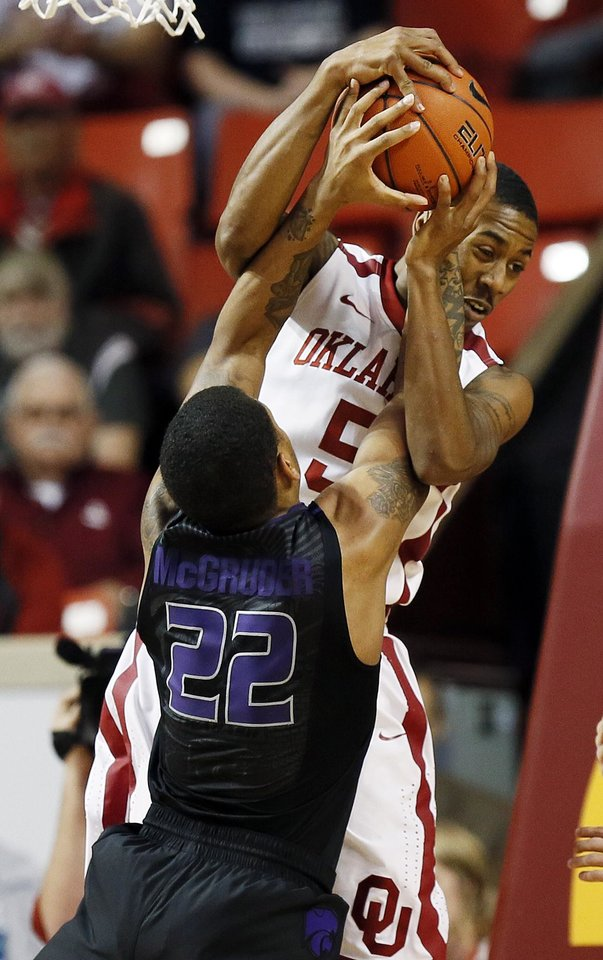 Photo - Oklahoma's Je'lon Hornbeak (5) battles for a rebound with Kansas State's Rodney McGruder (22) during an NCAA men's basketball game between the University of Oklahoma (OU) and Kansas State at the Lloyd Noble Center in Norman, Okla., Saturday, Feb. 2, 2013. Photo by Nate Billings, The Oklahoman