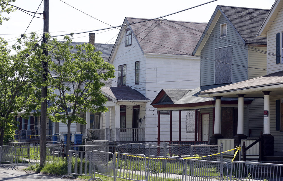 Photo - The house is shown where three women were held in Cleveland, Ohio, Thursday, May 9, 2013.  Ariel Castro was charged with four counts of kidnapping and three counts of rape.  Ariel Castro was charged while his brothers, Pedro and Onil Castro, were held but faced no immediate charges.(AP Photo/David Duprey)