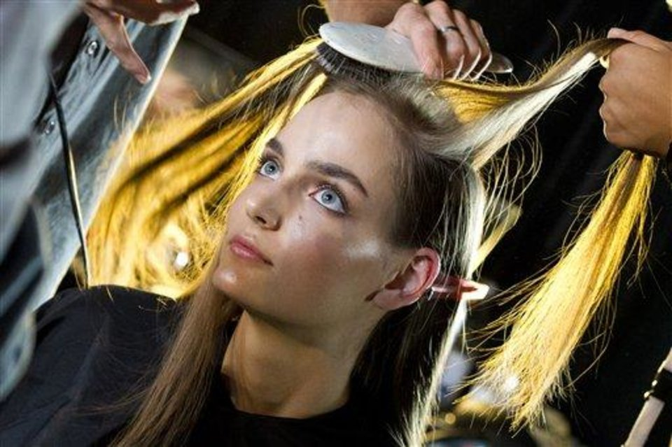 Photo - A model gets her hair done backstage at the Diesel Black Gold Spring 2013 show during Fashion Week in New York on Tuesday, Sept. 11, 2012. (Photo by Charles Sykes/Invision/AP)