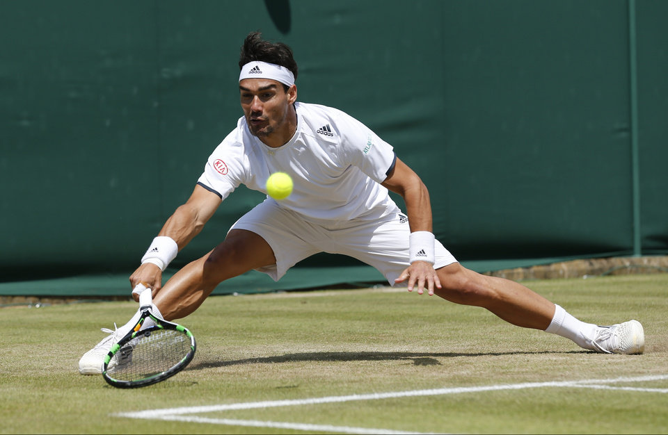 Photo - Fabio Fognini of Italy plays a return to Kevin Anderson of South Africa uring their men's singles match at the All England Lawn Tennis Championships in Wimbledon, London, Friday, June 27, 2014. (AP Photo/Ben Curtis)