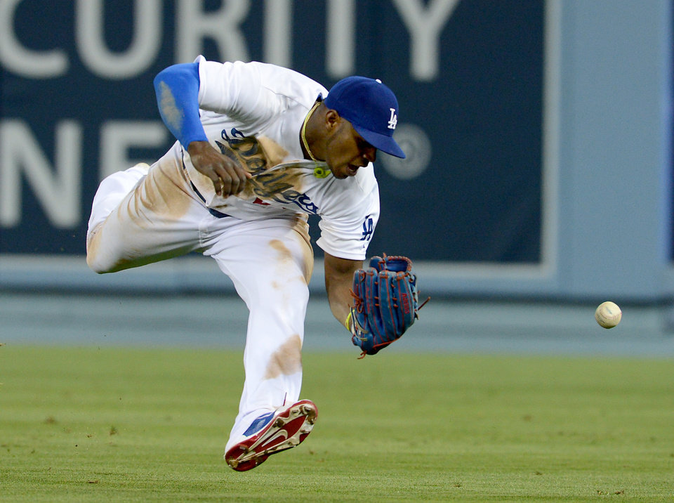 Photo - Los Angeles Dodgers' Yasiel Puig misses a double by Arizona Diamondbacks' Martin Prado in the sixth inning of a baseball game on Saturday, June 14, 2014, in Los Angeles. (AP Photo/Jayne Kamin-Oncea)