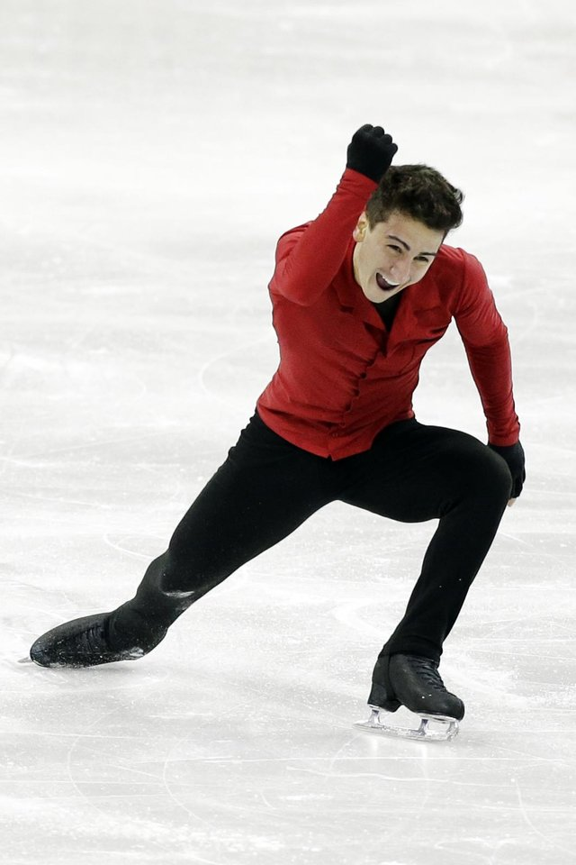 Max Aaron celebrates after finishing his program in the senior men's free skate program at the U.S. figure skating championships in Omaha, Neb., Sunday, Jan. 27, 2013. Aaron won his first title in a rout to jump from fourth to first, finishing with 255 points overall. (AP Photo/Nati Harnik)