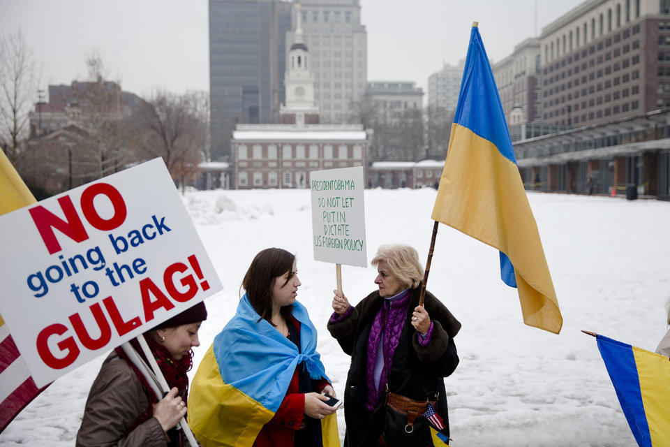 Photo - Members of the Ukrainian American communitie demonstrate in support Ukrainian anti-government protesters outside Independence Hall, Wednesday, Feb. 19, 2014, in Philadelphia. The violence on Tuesday was the worst in nearly three months of anti-government protests that have paralyzed Ukraine's capital, Kiev, in a struggle over the identity of a nation divided in loyalties between Russia and the West, and the worst in the country's post-Soviet history. (AP Photo/Matt Rourke)