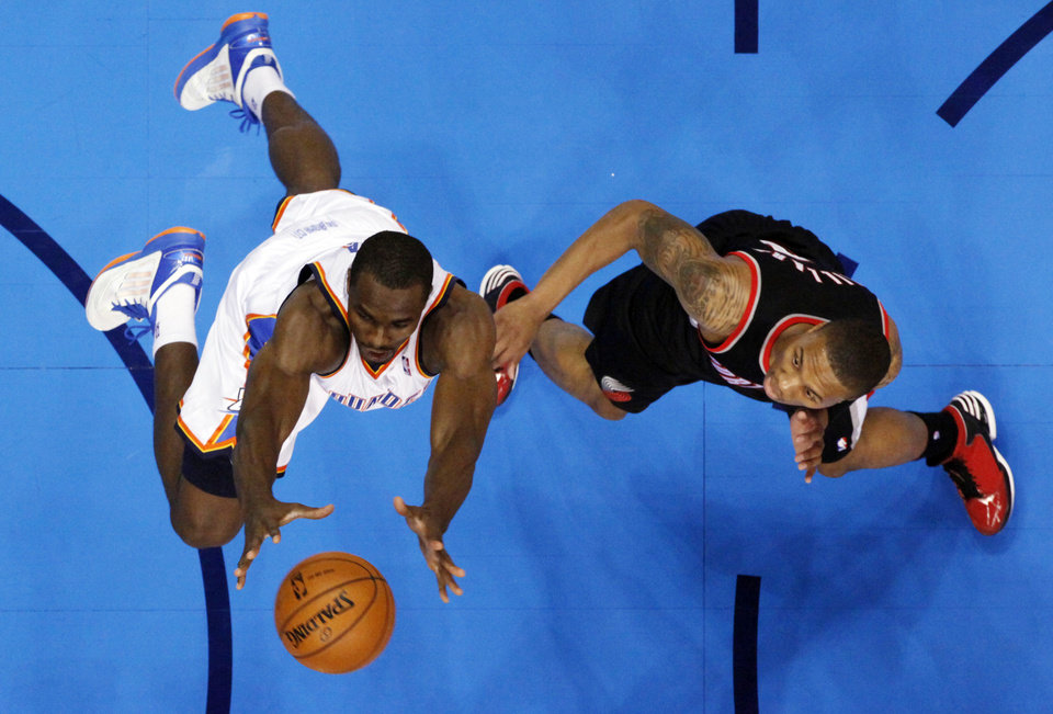Photo - Oklahoma City Thunder's Serge Ibaka, left, and Portland Trail Blazers' Damian Lillard go for a rebound as the Oklahoma City Thunder defeat the Portland Trail Blazers 106-92 in NBA basketball at the Chesapeake Energy Arena in Oklahoma City, on Friday, Nov. 2, 2012.  Photo by Steve Sisney, The Oklahoman