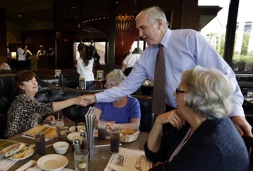 Photo - Republican U.S. Senate hopeful Michael Sullivan greets diners at Christo's in Brockton, Mass., Monday, April 29, 2013. Three Republicans and two Democrats seeking the nominations of their parties to run in a special U.S. Senate election to fill the Massachusetts seat formerly held by Secretary of State John Kerry are making a final pre-primary push for votes. A light turnout is expected for Tuesday's primary. (AP Photo/Elise Amendola)