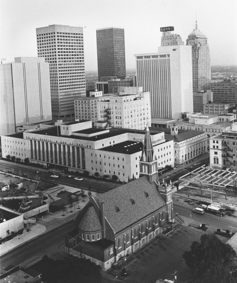 OKLAHOMA CITY / SKY LINE / OKLAHOMA:  For downtown watchers, here's an updated view of the Oklahoma City skyline, as seen from a vantage point in The Regency Tower.  as a contrast of old and new, in the foreground is a city landmark, St. Joseph's Old Cathedral, 519 N. Harvey.  Staff photo by Monty Reed.  Phtoo dated 06/27/1977 and Published on 10/09/1977 in The Daily Oklahoman and again on 04/13/1978 in The Oklahoma City Times (BS).