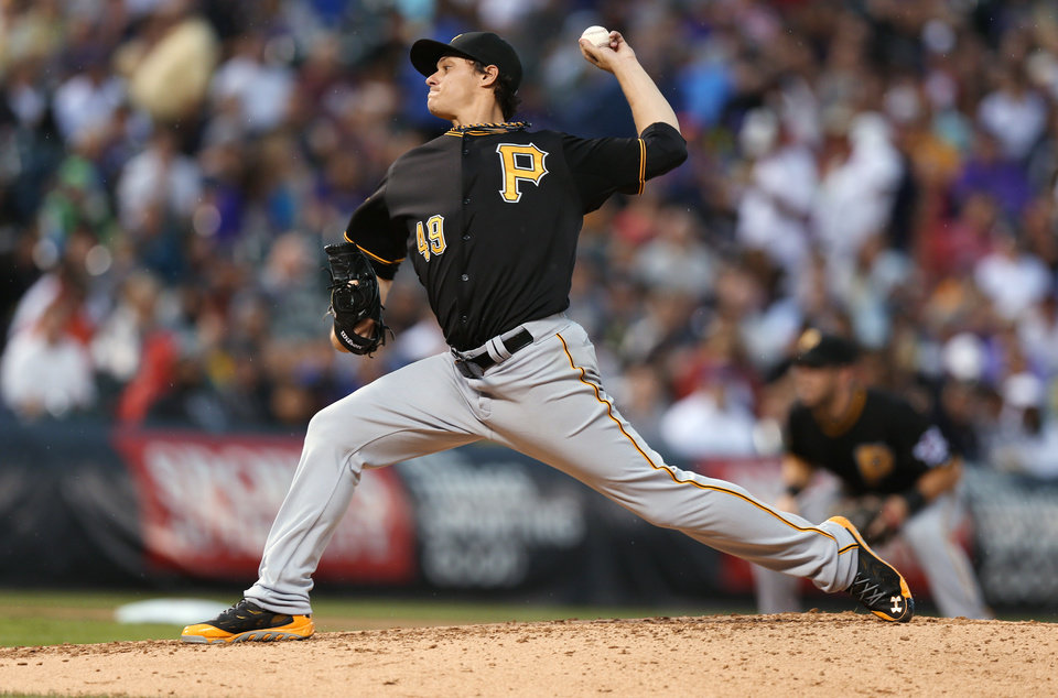 Photo - Pittsburgh Pirates starting pitcher Jeff Locke throws to a Colorado Rockies batter in the fourth inning of a baseball game in Denver on Saturday, July 26, 2014. (AP Photo/David Zalubowski)