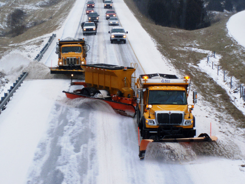 Photo - This photo shows a tow plow -- a snow plow that tows another plow -- in operation in Missouri. Oklahoma Turnpike Authority officials said they will have two tow plows available for use if expected wintry weather arrives in the state. PHOTO PROVIDED BY OKLAHOMA TURNPIKE AUTHORITY