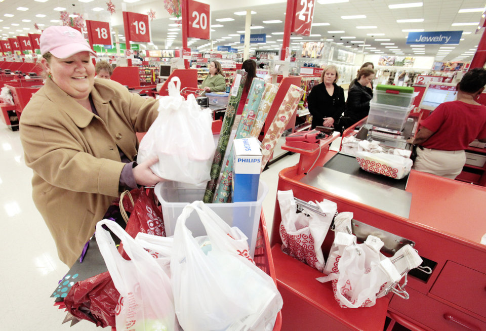 Heidi Hoskinson loads her cart with after Christmas sales items at the Target on Memorial, Monday, December 26, 2011.  Photo by David McDaniel, The Oklahoman