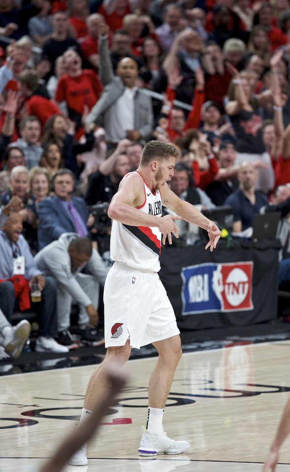 Photo - Portland Trail Blazers forward Meyers Leonard reacts after making a 3-point basket against the Oklahoma City Thunder during the second half of Game 2 of an NBA basketball first-round playoff series Tuesday, April 16, 2019, in Portland, Ore. (AP Photo/Craig Mitchelldyer)
