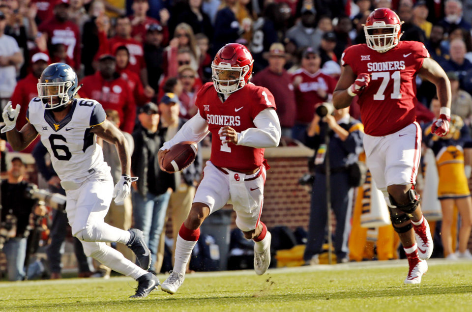 Photo - Oklahoma's Kyler Murray (1) takes the first play of the game for a long gain during a college football game between the University of Oklahoma Sooners (OU) and the West Virginia Mountaineers at Gaylord Family-Oklahoma Memorial Stadium in Norman, Okla., on Saturday, Nov. 25, 2017. Photo by Steve Sisney, The Oklahoman