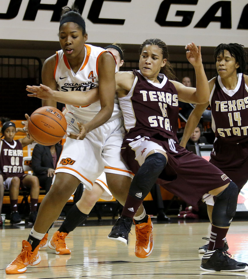 Photo - Oklahoma State's LaShawn Jones (55) and Texas State's Jasmine Baugus (15) fight for the ball during a women's college basketball game between Oklahoma State University and Texas State at Gallagher-Iba Arena in Stillwater, Okla., Wednesday, Nov. 28, 2012.  Photo by Bryan Terry, The Oklahoman