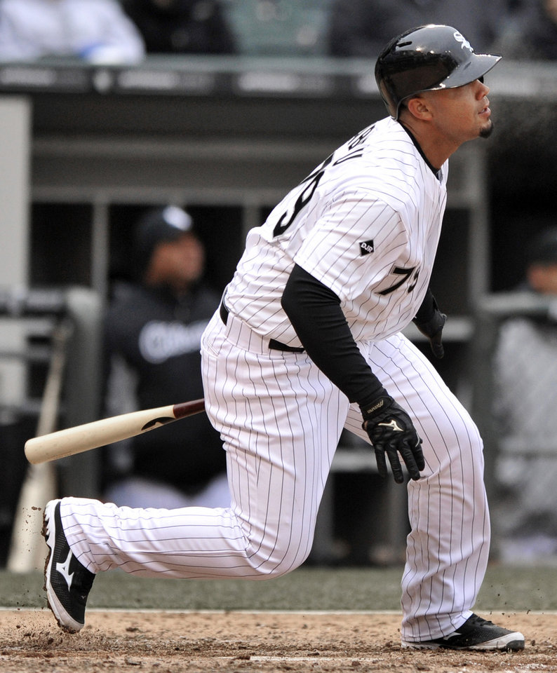 Photo - Chicago White Sox's Jose Abreu watches his three-run triple during the sixth inning of a baseball game against the Minnesota Twins in Chicago, Thursday, April 3, 2014. (AP Photo/Paul Beaty)