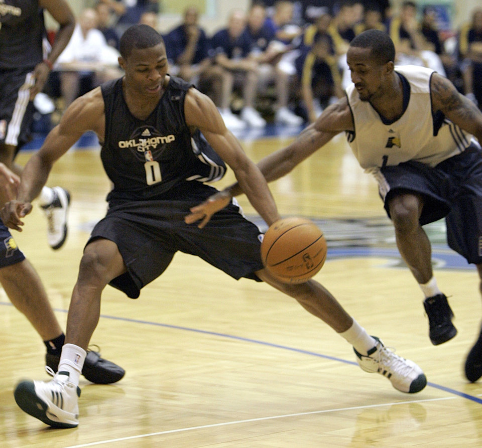 Photo - OKC NBA, FORMER SEATTLE SUPERSONICS, SONICS BASKETBALL TEAM: Oklahoma City's Guard Russell Westbrook (0) scrambles for a loose ball against Indiana Pacers' Earl Calloway during an NBA summer league basketball game in Orlando, Fla., Monday, July 7, 2008. (AP Photo/John Raoux) ORG XMIT: FLJR105