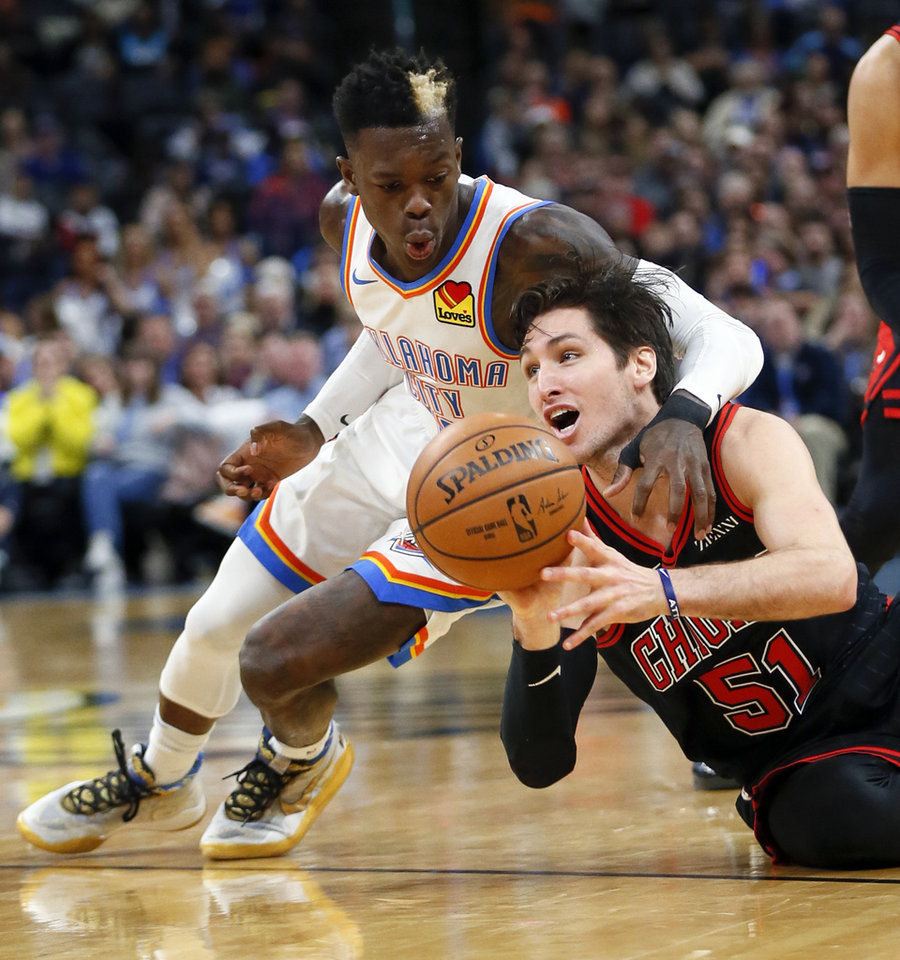 Photo - Chicago's Ryan Arcidiacono (51) passes the ball away from Oklahoma City's Dennis Schroder (17) after a Thunder turnover in the second quarter during an NBA basketball game between the Oklahoma City Thunder and Chicago Bulls at Chesapeake Energy Arena in Oklahoma City, Monday, Dec. 16, 2019. [Nate Billings/The Oklahoman]