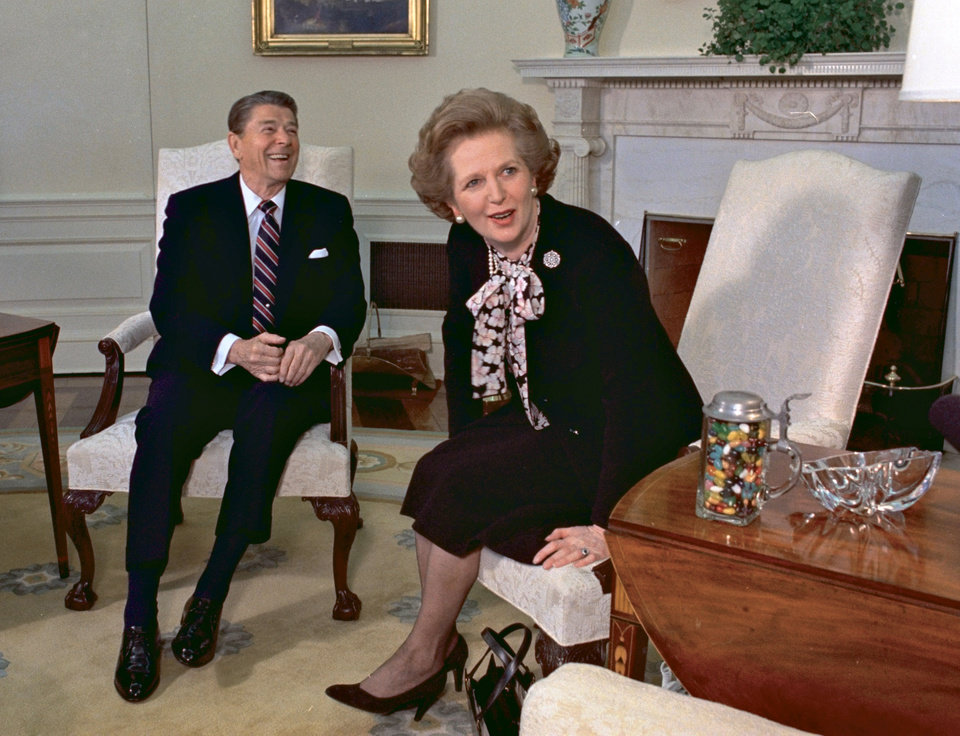 Photo - FILE - In this Feb. 20, 1985 file photo, former British Prime Minister Margaret Thatcher meets with her friend and political ally President Ronald Reagan during a visit to the White House in Washington. Thatcher, who led Britain for 11 years, died of a stroke Monday morning, April 8, 2013. (AP Photo/J. Scott Applewhite, file)