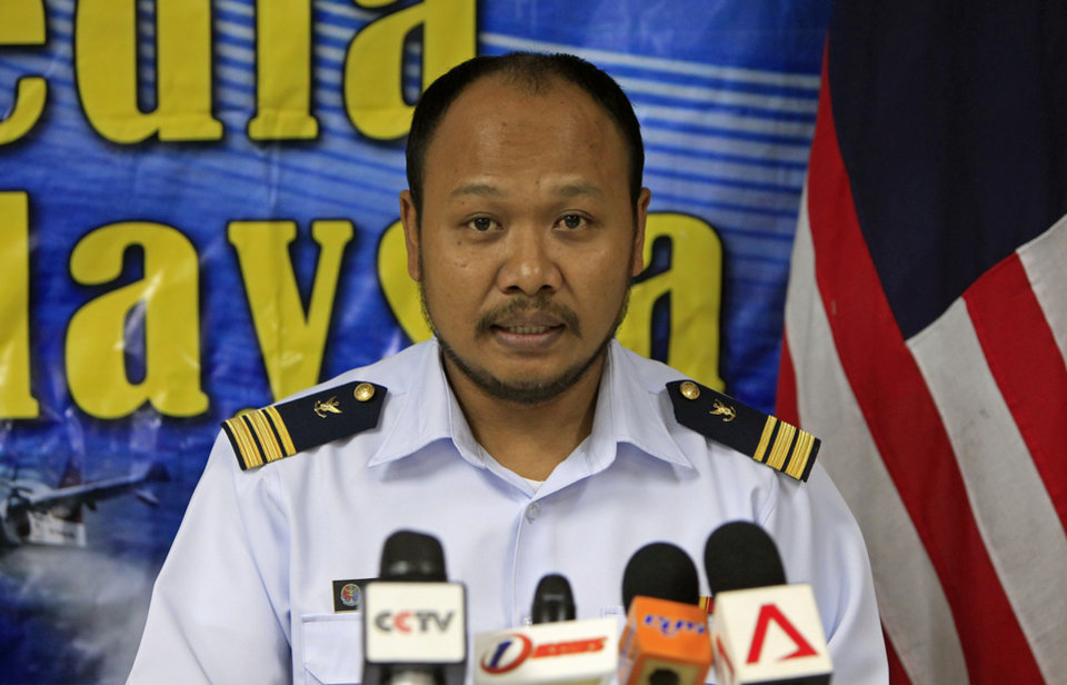 Photo - Malaysian Maritime Enforcement Agency's Port Klang office head Mohamad Hambali Yaakup speaks during a press conference in Port Klang, outside Kuala Lumpur, Malaysia, Wednesday, June 18, 2014. At least 60 people survived when a wooden boat carrying 97 Indonesian migrants capsized and sank after leaving Malaysia's west coast, but 35 others are still missing and two bodies have been recovered, Malaysia's maritime agency said Wednesday. (AP Photo/Lai Seng Sin)