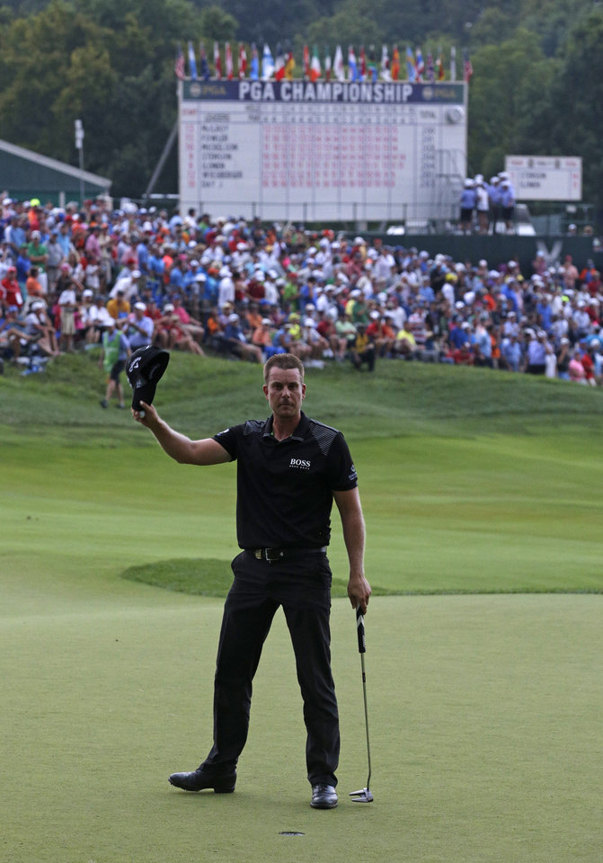 Photo - Henrik Stenson, of Sweden, waves to the crowd on the 18th hole during the final round of the PGA Championship golf tournament at Valhalla Golf Club on Sunday, Aug. 10, 2014, in Louisville, Ky. (AP Photo/John Locher)
