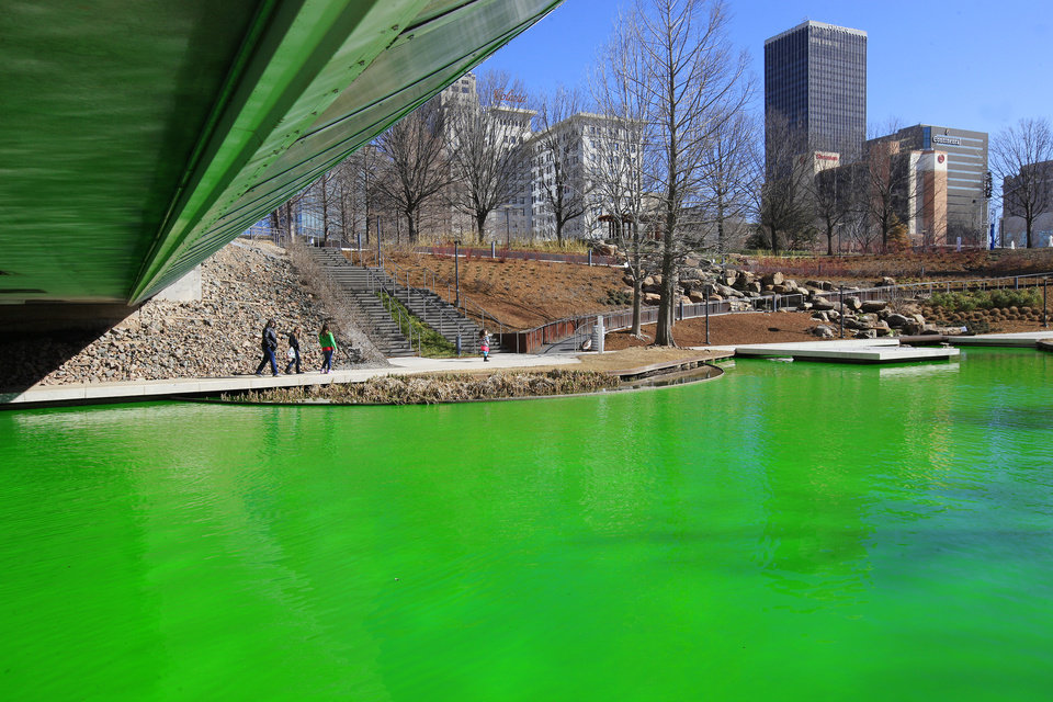 Photo -      Above: A lake reflects green Monday after a prankster treated the water system at the Myriad Botanical Gardens with green dye in Oklahoma City. Photos by Paul B. Southerland, The Oklahoman   PAUL B. SOUTHERLAND -