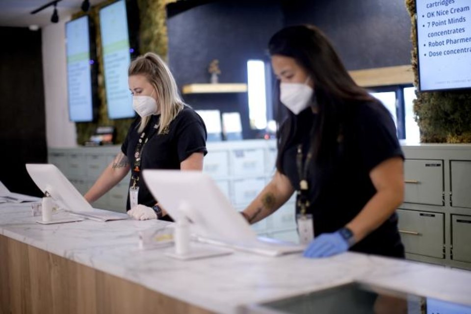 Photo -  Betty Tran, right, and Bethany Gryder work inside Likewise Cannabis, 6808 N May Ave. [BRYAN TERRY/THE OKLAHOMAN]