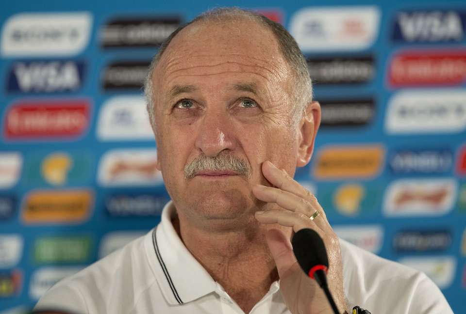 Photo - Brazil's coach Luiz Felipe Scolari looks on during a news conference the day before the group A World Cup soccer match between Brazil and Cameroon at the Estadio Nacional in Sunday, June 22, 2014. The hosts need at least a draw to advance to the second round, and a win will likely secure first place. Cameroon is already eliminated after losing its first two matches. (AP Photo/Andre Penner)