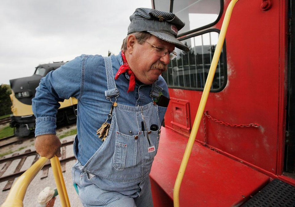Photo -  Engineer Guy Lynn climbs aboard a locomotive before giving a train ride at the Oklahoma Railway Museum, 3400 NE Grand Blvd., in Oklahoma City, Saturday, April 7, 2012. The museum gives train rides the 1st and 3rd Saturday from April through August. Photo by Nate Billings, The Oklahoman