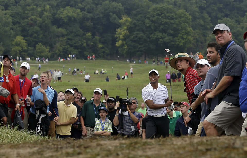 Photo - Tiger Woods hits from rough on the sixth hole during the second round of the PGA Championship golf tournament at Valhalla Golf Club on Friday, Aug. 8, 2014, in Louisville, Ky. (AP Photo/Jeff Roberson)