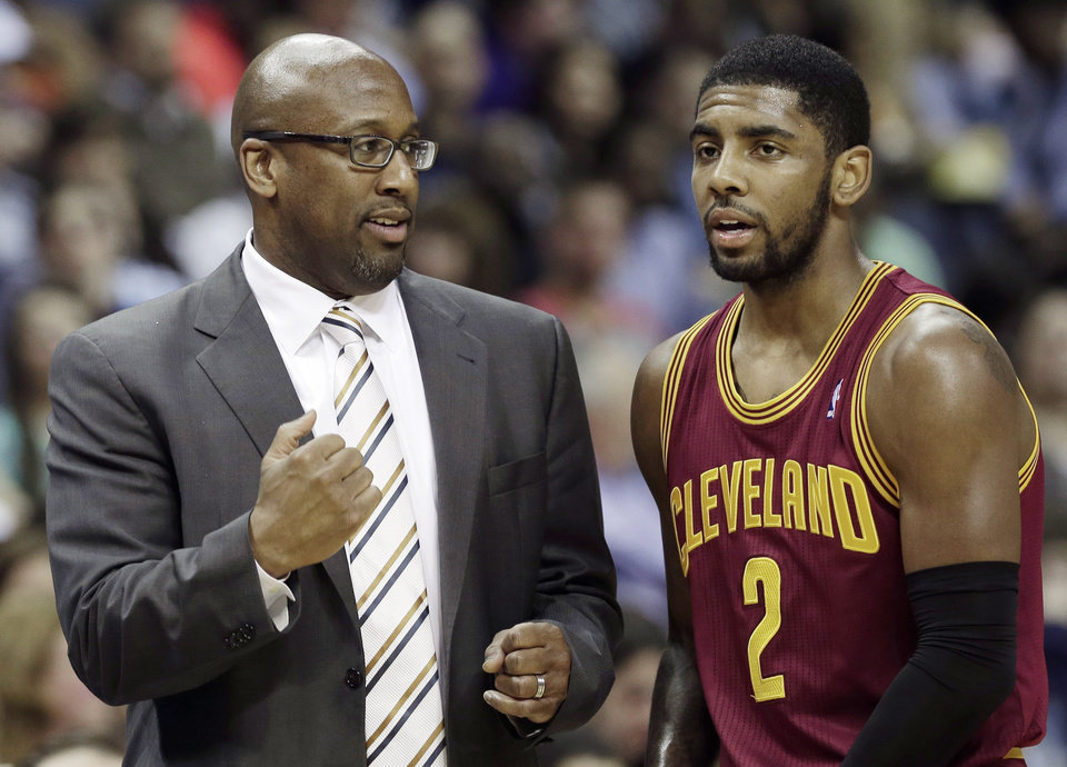 Photo - Cleveland Cavaliers coach Mike Brown, left, talks with Kyrie Irving during the first half of an NBA basketball game against the Memphis Grizzlies in Memphis, Tenn., Saturday, March 1, 2014. (AP Photo/Danny Johnston)