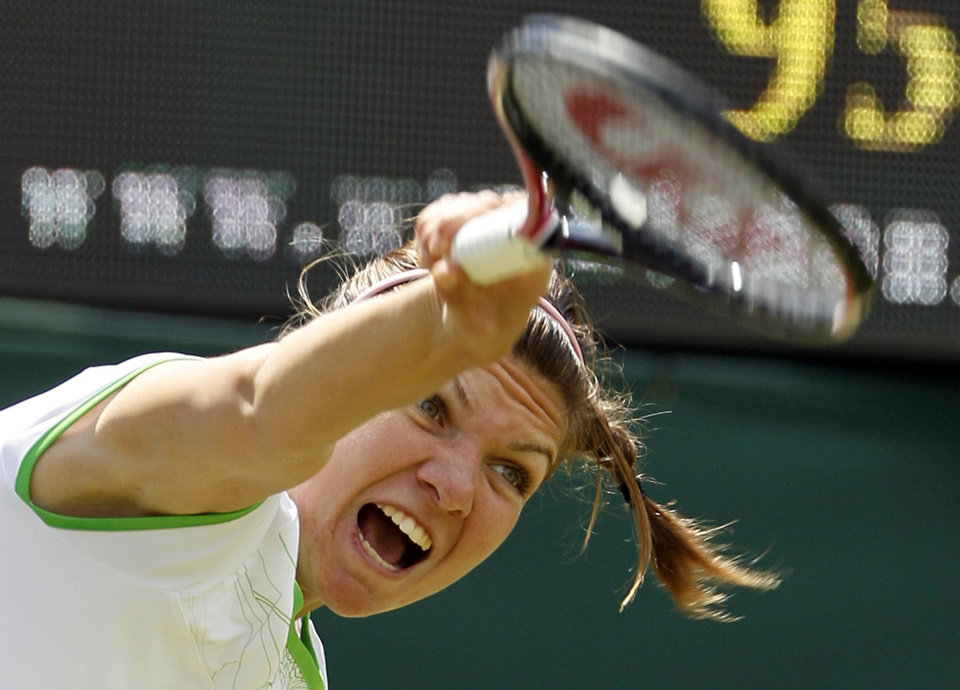 Photo - ADVANCE FOR WEEKEND EDITIONS, JUNE 21-22 - FILE - In this June 23, 2011, file photo, Romania's Simona Halep serves to Serena Williams, of the United States, during their match at the All England Lawn Tennis Championships at Wimbledon.. (AP Photo/Alastair Grant, File)