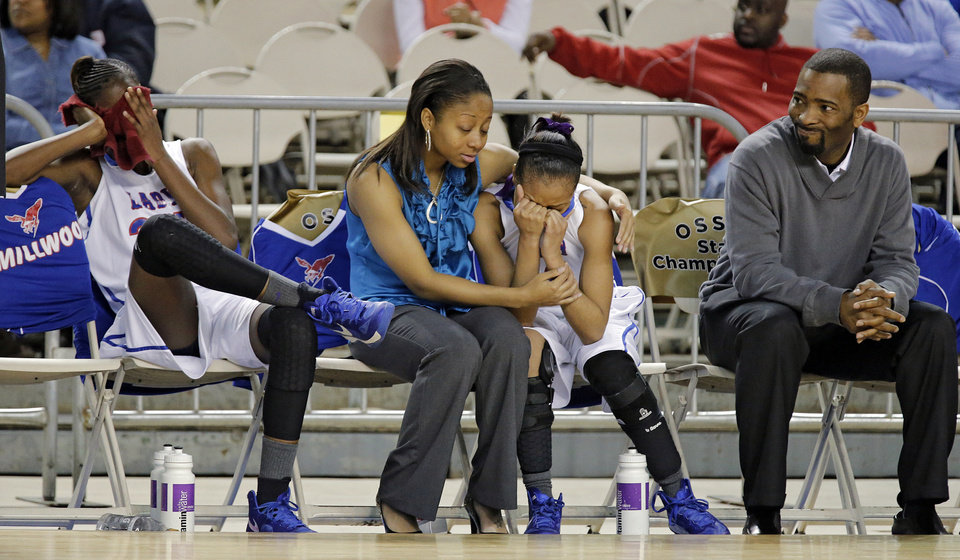The Millwood bench reacts to the 63-42 loss to Perkins during the state high school basketball tournament Class 3A girls semifinal game between Millwood High School and Perkins High School at the State Fair Arena on Friday, March 8, 2013, in Oklahoma City, Okla. Photo by Chris Landsberger, The Oklahoman