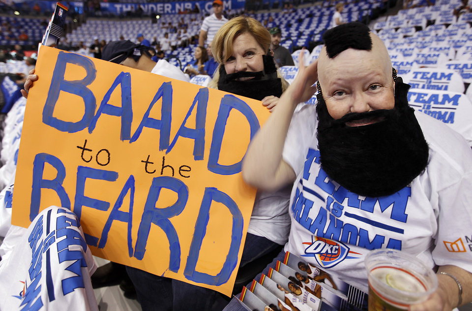 Photo - Thunder fans Penny Olivier and Paula Young, from left, wear their fake beards during Game 2 in the second round of the NBA playoffs between the Oklahoma City Thunder and the L.A. Lakers at Chesapeake Energy Arena on Tuesday,  May 15, 2012, in Oklahoma City, Oklahoma. Young just finished a round of chemotherapy. Photo by Chris Landsberger, The Oklahoman