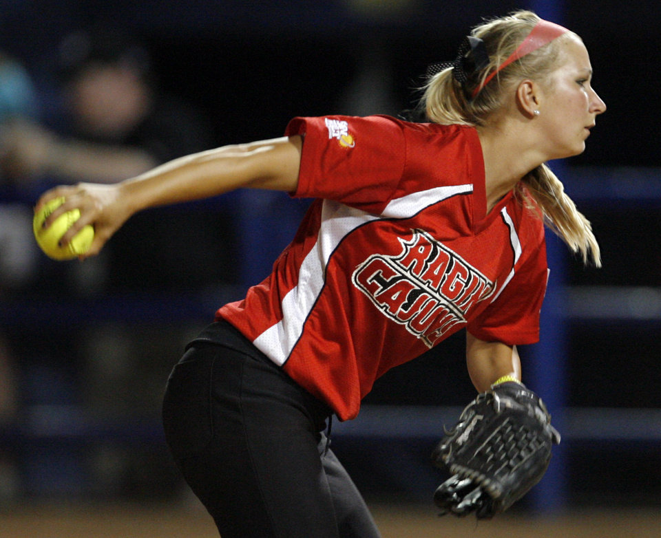 Photo - Donna Bourgeois (21) pitches during the softball game in the Women's College World Series between Louisiana-Lafayette and Alabama at ASA Hall of Fame Stadium in Oklahoma City, Saturday, May 31, 2008. BY NATE BILLINGS, THE OKLAHOMAN