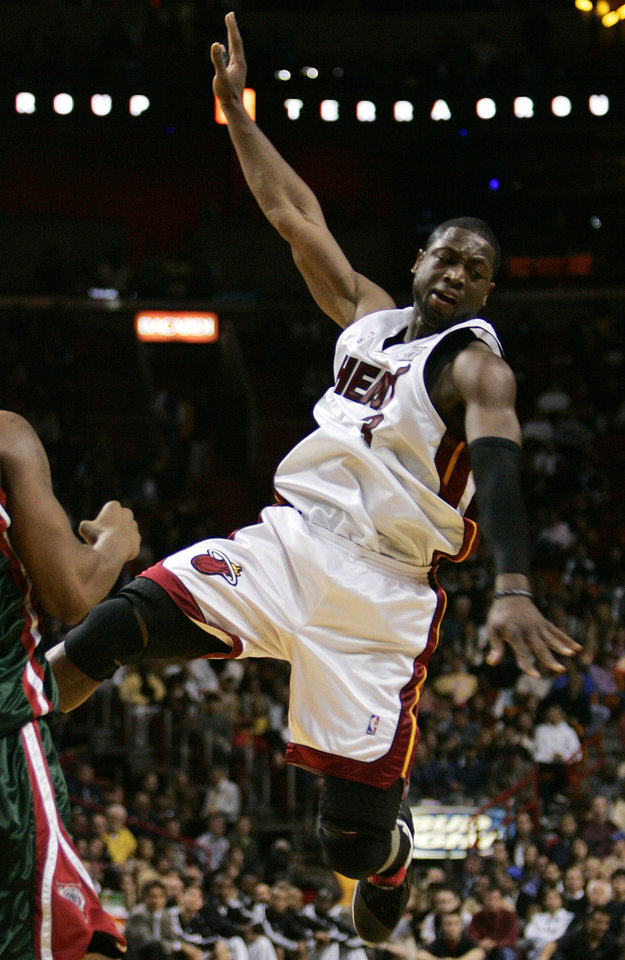 Photo - Miami Heat guard Dwyane Wade loses control of the ball in the third quarter during a basketball game against the Milwaukee Bucks in Miami Wednesday, Jan. 2, 2008. Wade was the top scorer for the Heat with 27 points, but the Bucks won 103-98. (AP Photo/Lynne Sladky) ORG XMIT: AAA106,NYEOTK