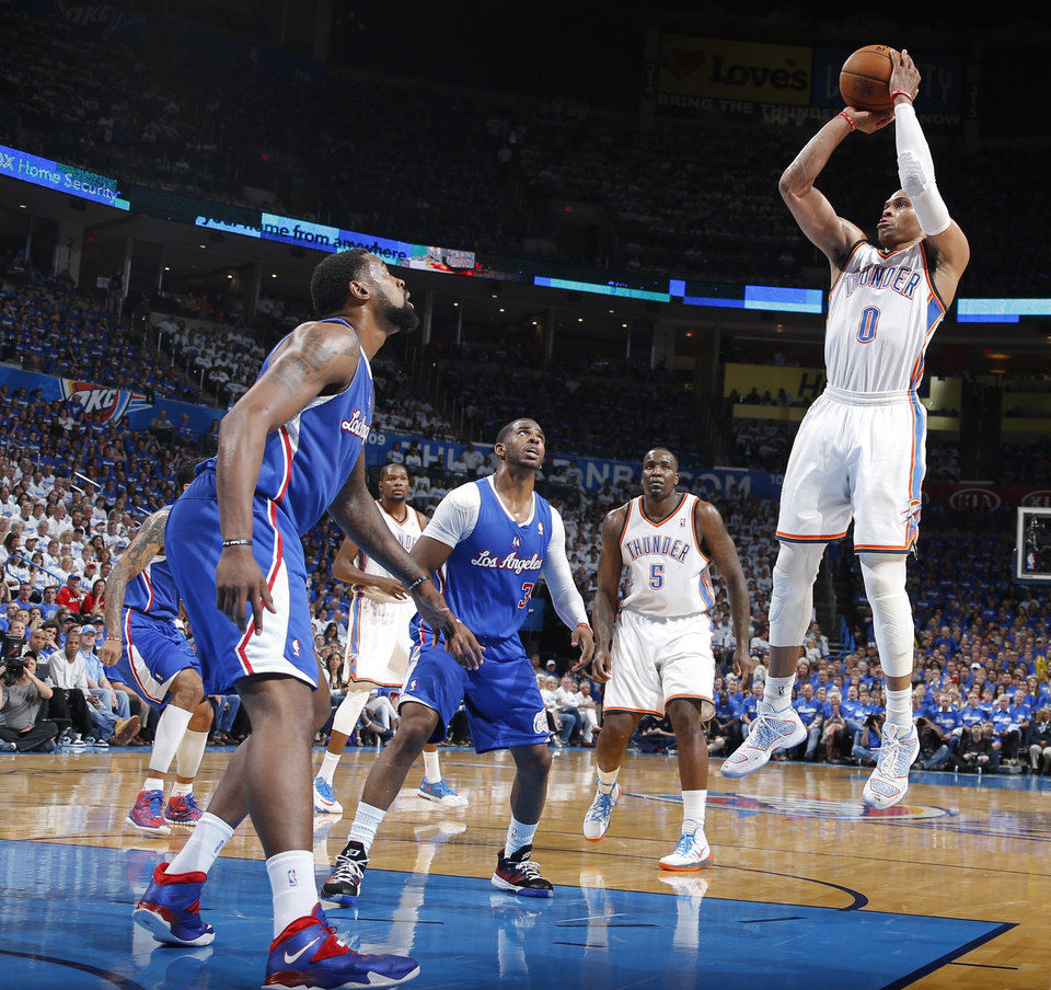 Photo - Russell Westbrook stops and shoots a jumper during Game 2 of the Western Conference semifinals in the NBA playoffs between the Oklahoma City Thunder and the Los Angeles Clippers at Chesapeake Energy Arena in Oklahoma City, Wednesday, May 7, 2014. Photo by Bryan Terry, The Oklahoman