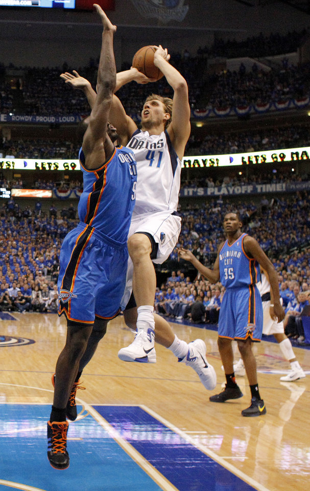 Dirk Nowitzki (41) of Dallas goes to the basket against Oklahoma City's Serge Ibaka (9) during game 2 of the Western Conference Finals in the NBA basketball playoffs between the Dallas Mavericks and the Oklahoma City Thunder at American Airlines Center in Dallas, Thursday, May 19, 2011. Photo by Bryan Terry, The Oklahoman